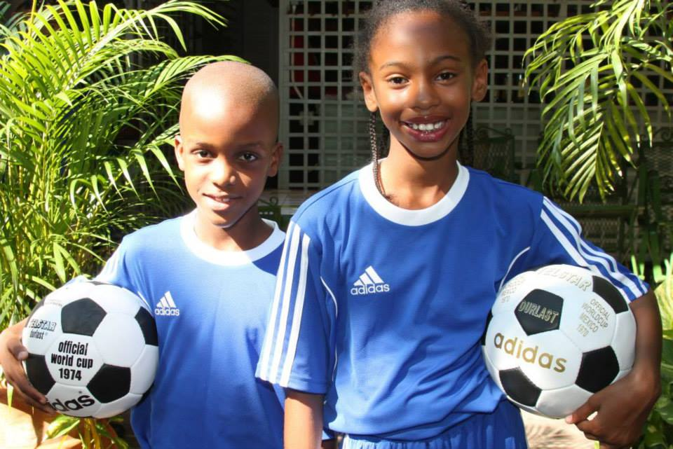 Kid models Elijah with Adidas Telstar, The Official Football of the FIFA World Cup 1970 in Mexico & Somoya with the Adidas Durlast, The Official Football of the FIFA World Cup1974 in Germany