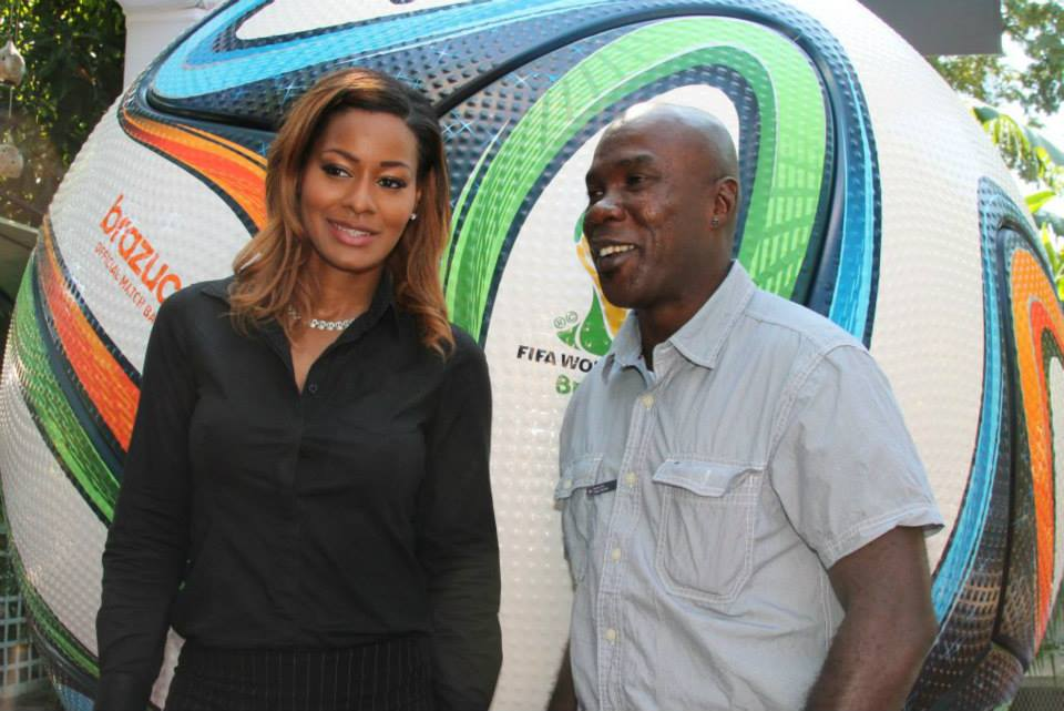 Original Reggae Boy striker Walter Boyd & Sports Max Marketing Manager Tanye Lee share a moment at the launch of the Adidas Brazuca World Cup Football in Kingston Jamaica,
