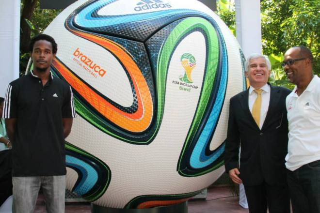 Counsellor Alfonso Celso Nery from the Embassy of Brazil in Jamaica unveils the Adidas Brazuca World Cup Football with Gavin Smith of Western Sports Jamaica & Adidas Jamaica rep.