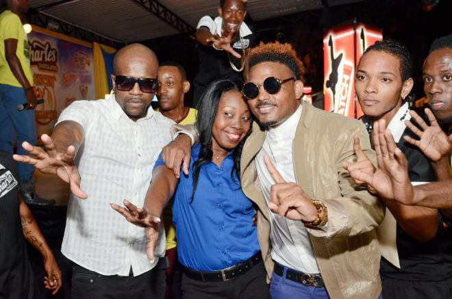 Roxanne Brown, Brand Manager Charles Chocolate and Devon Biscuits joins Voicemail to celebrate the signing of the dancehall duo as Charles Chocolate Ambassadors.  Charles Chocolate Dancers from the Black Eagles Troupe rally around the stage.